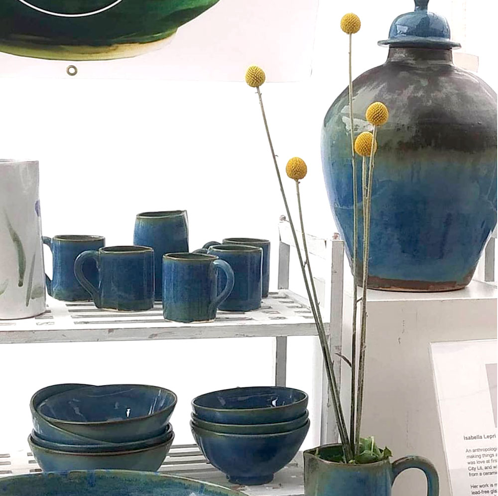 Blue stoneware bowls, cups and lidded vase