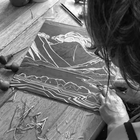 Emily Brooks carving a lino block
